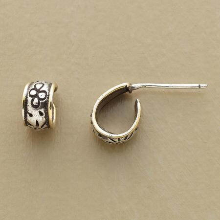 These pretty little handmade silver and gold hoop earrings unfurl a floral scroll from the ear.