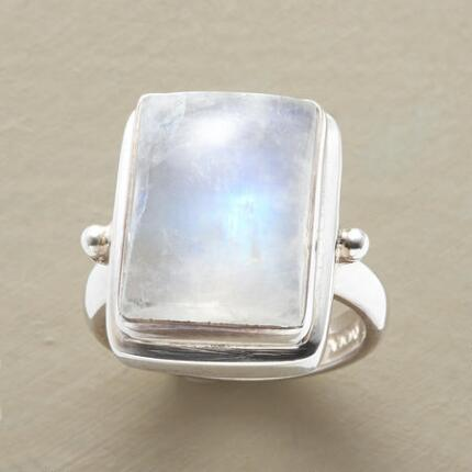 Stunningly sublime, this rainbow moonstone cabochon ring looks like something out of a dream.