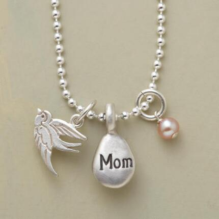 A thoughtful, timeless charm necklace for mom that will make her smile every time she wears it.