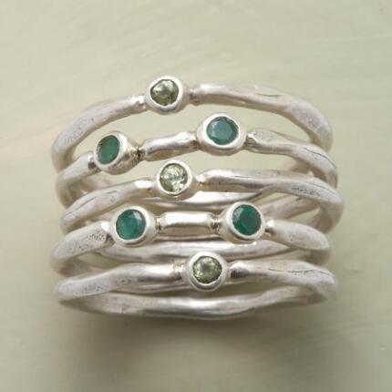 Accented with verdant jewels, these handmade stack rings make a lovely addition to any outfit.