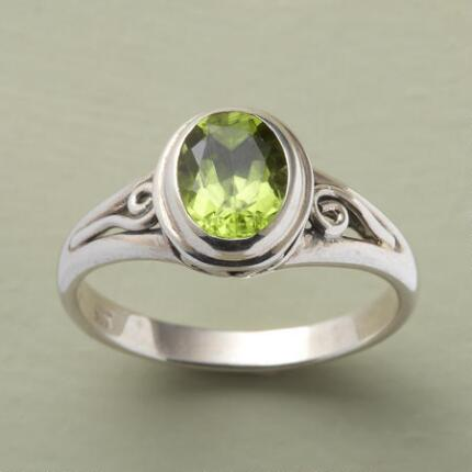 A lively scrolled green peridot ring that will add a flash of color to your look.