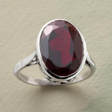 Deeply alluring, this red garnet Ophelia ring is utterly enchanting.