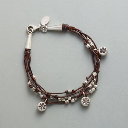 You'll love the wear-everywhere style of this knot and sterling bead bracelet.