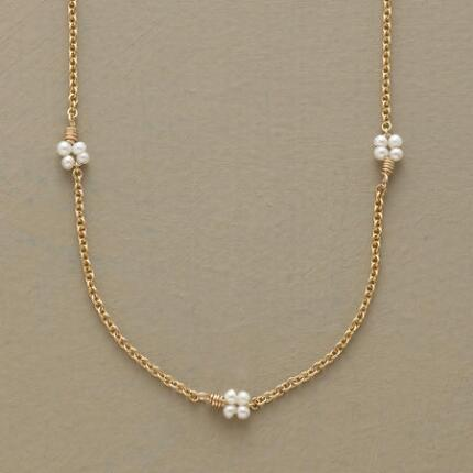 Dainty as can be, this lovely lucky lady pearl necklace makes a felicitous touch in any ensemble.