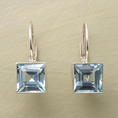 These handmade blue topaz earrings stun with their faceted brilliance.