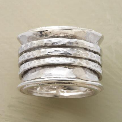 Melodious and elegant, this tambourine spinner ring is a classic with a musical twist.