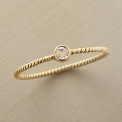 Divinely dainty, this champagne & roses diamond ring has intoxicating charm.