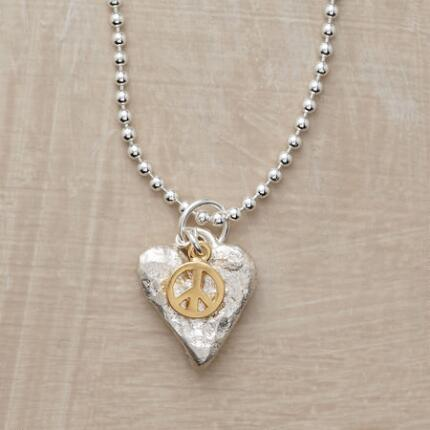 A pretty heart and peace symbol pendant necklace that makes a shining statement.
