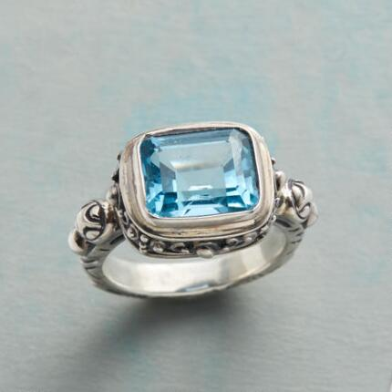 Let your gaze swim laps in this handmade blue topaz ring's inviting depths.