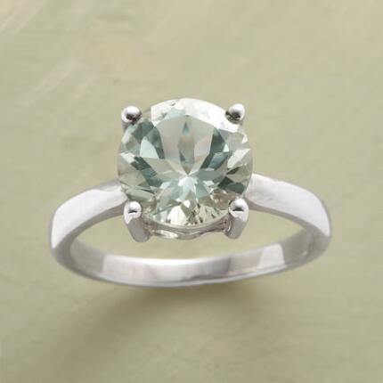 The minimalist band of this green amethyst enlightenment ring puts the piece's sparkle front and center.