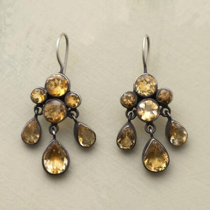 A pair of Jane Diaz dangling citrine earrings that exudes a romantic air.