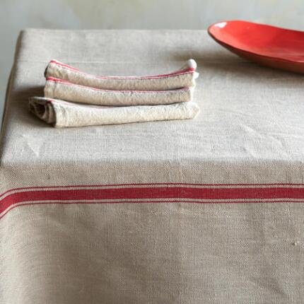 Our striped linen tablecloth sets the stage for a charming occasion.