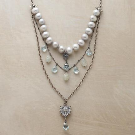 Sumptuously bejeweled, this pearl and pendant necklace is a stunning accessory.