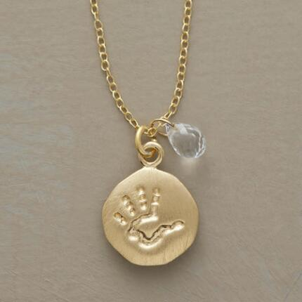 A personalized birthstone and handprint necklace that keeps that most cherished bond in mind.