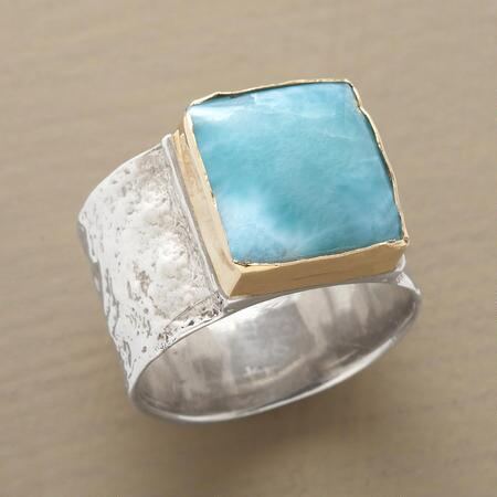 A handcrafted larimar ring with color as exquisite as the band's design.