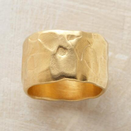 An old soul gold ring, evoking the passage of eras, yet timeless.
