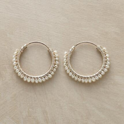 Sweetly delicate, these circle of pearls hoop earrings make a timeless statement.