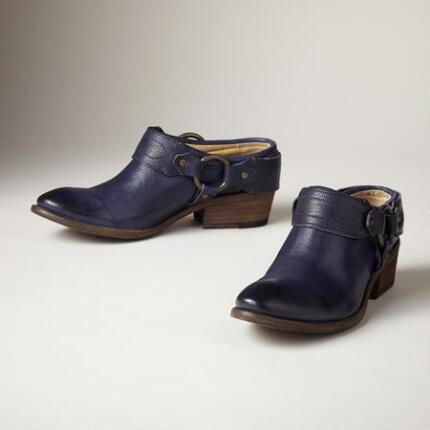 A pair of leather clogs from Frye® that combine comfort and versatile style.