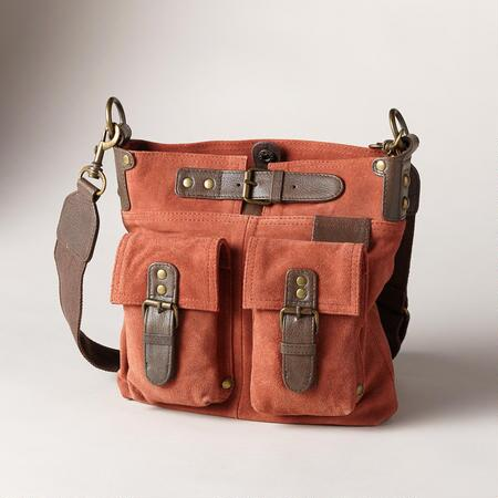 A fun and functional suede explorer bag with looks fit to conquer the globe.