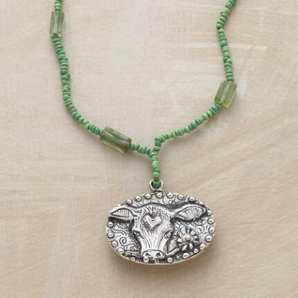 Touchingly evocative, this Jes MaHarry green tourmaline pendant necklace is a sweet and pretty piece.