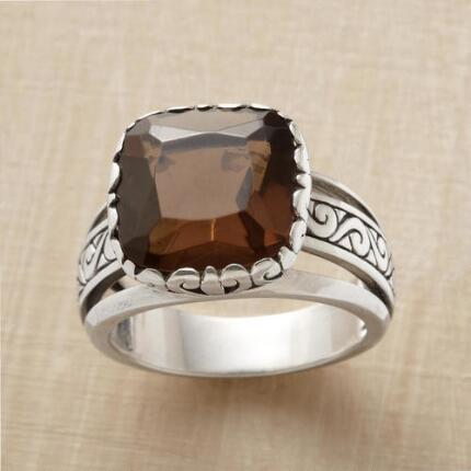 Add a majestic air to your look with this smoky quartz crown ring.