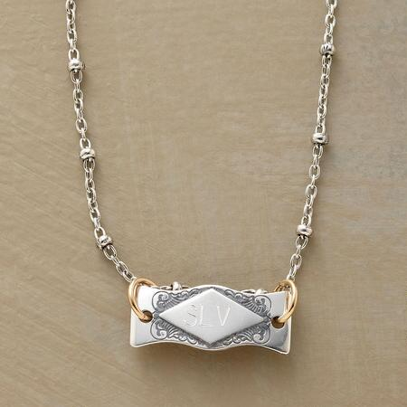 An elegant personalized I.D. tag necklace that delivers an element of highly individual style.