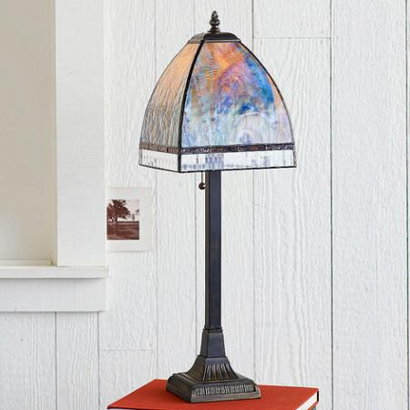 This stained glass lamp lends a sense of magic to any space's ambience.
