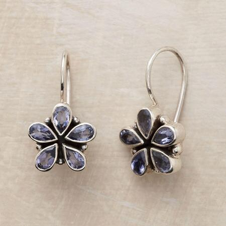 Sweet and sparkly, these iolite flower earrings make a shining addition to any ensemble.