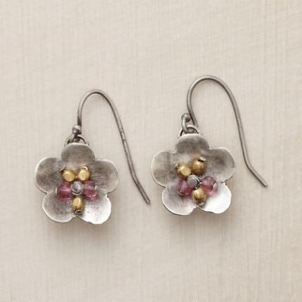 These tourmaline and brass flower earrings sway sweetly, like blossoms caught in a breeze.