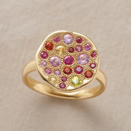 Dazzlingly aglow, this color wheel sapphire ring marries gorgeous materials with a playful sensibility.