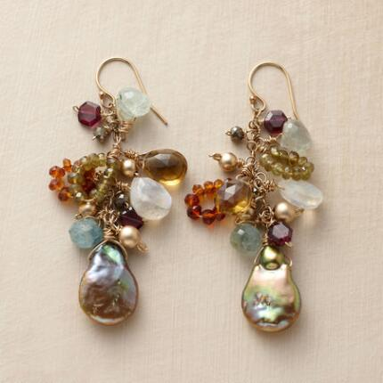 Overwhelmingly gorgeous, these dangling pearl and gemstone earrings are as sumptuous as can be.