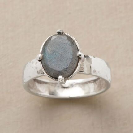 A striking labradorite crown ring that exudes a regal bearing.
