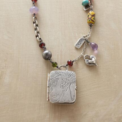A Jes MaHarry mother nature locket necklace that embodies pure love in a beautiful design.