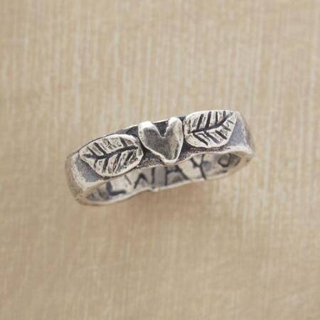 This sterling leaves and heart ring will win your affection with its sweet and simple style.