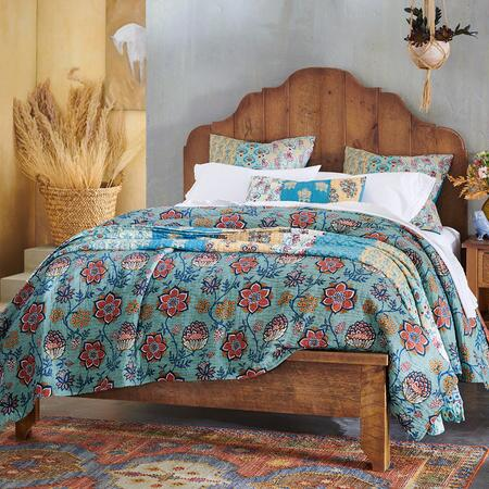 This vintage pine bed emanates a timeless sense of warmth that is welcome in any bedroom.