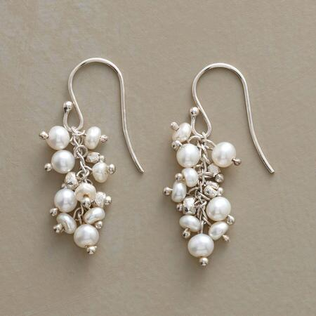 These lovely handmade dangling pearl earrings make the prettiest pearly melee.