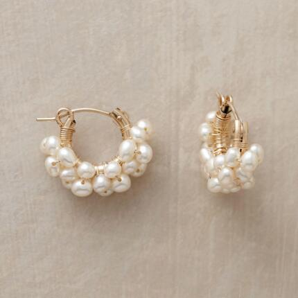 A pair of pearl wired hoop earrings that simply bubbles with charm.