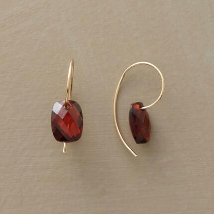 These lovely faceted almandine garnet earrings emanate a sumptuous warmth.