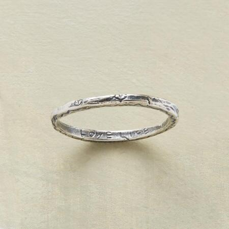 A message etched on this sterling silver vitality ring makes the band pleasing to the eye and the soul.
