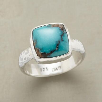 Let this handcrafted turquoise squared ring square away your look.