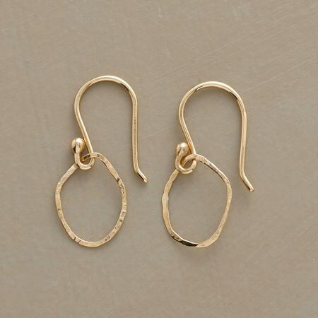 Elegantly irregular, these Anne Sportun gold hoop earrings make a unique statement.