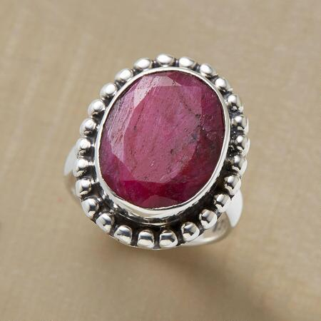 Simple yet striking, this oval ruby & silver ring adds a dash of romance to any ensemble.