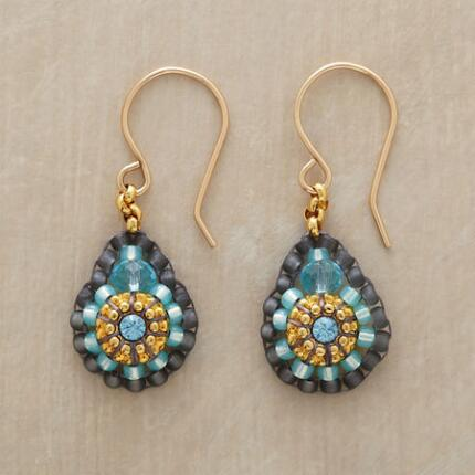 A pair of Miguel Ases blue quartz beaded earrings that delights with its ornate vibrancy.