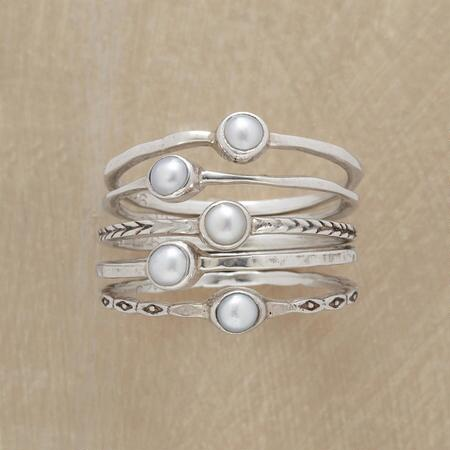Each pretty unto itself, the individual bands in this pearl stack ring set are perfect in combination.