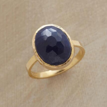 With a hue as deep and rich as the night sky, this domed blue sapphire ring is simply captivating.