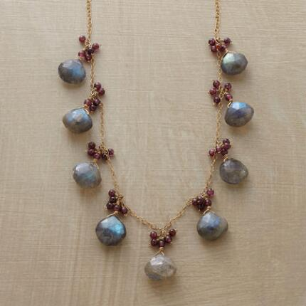 With moody hues and dazzling iridescence, this labradorite and garnet necklace is simply enchanting.