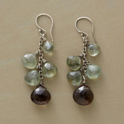 These aquamarine and smoky quartz earrings cast off alluring light from their richly colored gems.