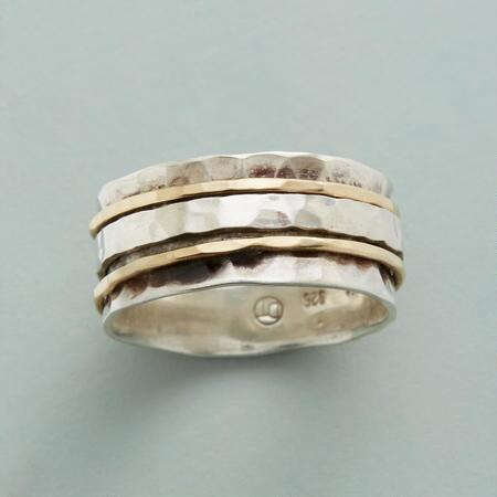 This elegant hand-hammered silver & gold partners ring makes the perfect accent for any outfit.