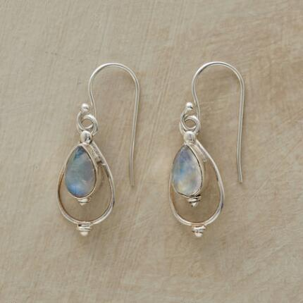 A pair of handmade moonstone lantern earrings with a design that swings and beams.