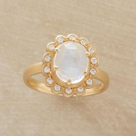 Lavishly embellished and bright, this magnum opus moonstone ring has a majestic air.